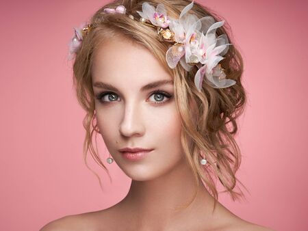 Young blonde woman with tiara on her head. Blonde girl with elegant and shiny hairstyle. Beautiful model woman with curly hairstyle. Care and beauty hair products. Perfect make-up