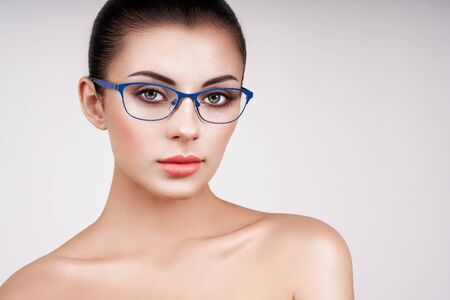 Woman with long eyelashes in eyeglasses. Vision correction. Poor eyesight. Spectacle frame. Makeup, cosmetics, beauty. Close up, macro