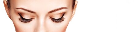 Female Eye with Extreme Long False Eyelashes. Eyelash Extensions. Makeup, Cosmetics, Beauty. Close up, Macro Stock Photo