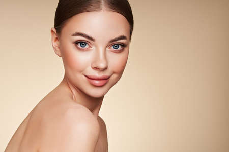 Portrait beautiful young woman with clean fresh skin. Model with healthy skin, close up portrait. Cosmetology, beauty and spa Standard-Bild