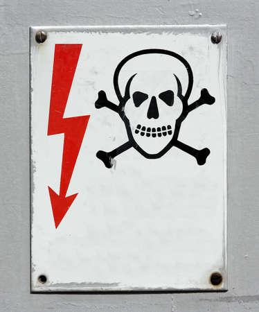 voltage gray: High voltage warning death skull sign Stock Photo