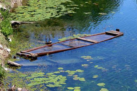 sunken boat: Sunken wooden river boat