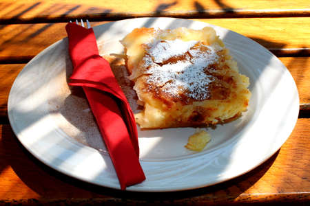 strudel: Freshly baked strudel with cheese sprinkled with cocoa and sugar