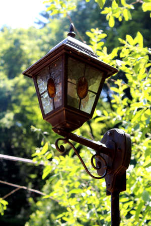 tempered: Old antique street lamp made from tempered iron Stock Photo