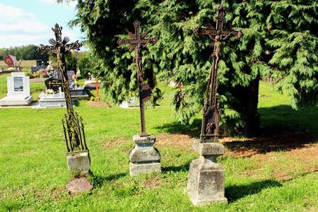 headstones: Three antique christian metal crosses used as headstones