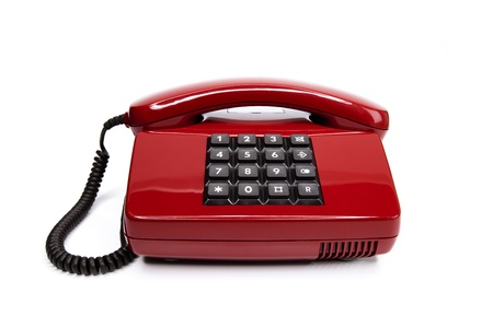 Classical red telephone from the eighties, isolated on a white background Stock Photo - 12041537