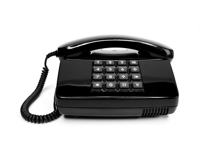 Classical black telephone from the eighties, isolated on a white background