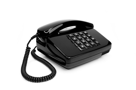 Classical black telephone from the eighties, isolated on a white background Stock Photo - 12041462