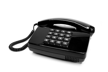 Classical black telephone from the eighties, isolated on a white background Stock Photo - 12041531