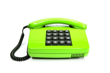 Classical green telephone from the eighties, isolated on a white background