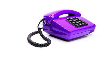 eighties: Classical lilac telephone from the eighties, isolated on a white background Stock Photo