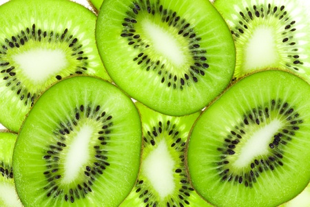 Kiwi fruit (chinese gooseberry) slices, one above the other