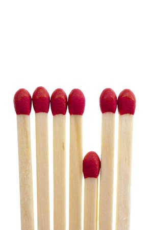 Get the short straw, symbolic with a row of matches, isolated on a white background Archivio Fotografico