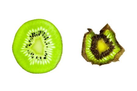 Senescence of a kiwi fruit slice (chinese gooseberry), isolated on a white background