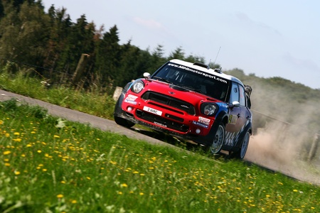 Trier, GERMANY, August 20, 2011 - Kris Meeke and his codriver Paul Nagle in their Prodrive Mini at the sunny SS9 (Birkenfelder Land 1) of the WRC ADAC Deutschland Rally 2011 Editorial