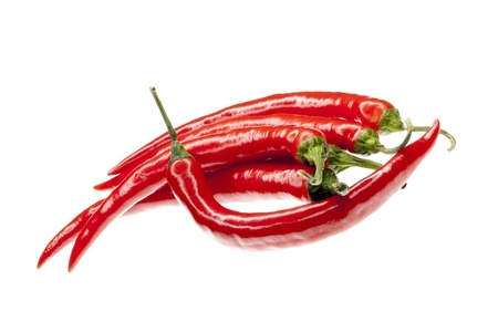 progeny: fresh red hot chili peppers, isolated on white background
