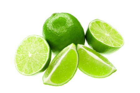 comestible: Fresh limes isolated on a white background