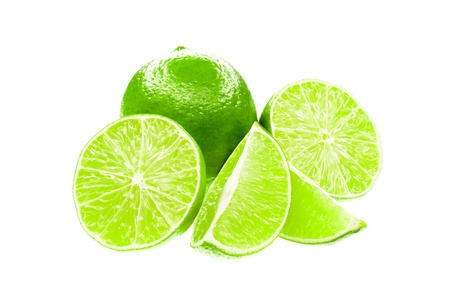 mellowness: Fresh limes isolated on a white background