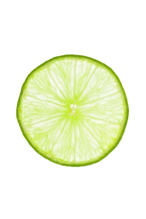 intense flavor: Fresh slice of lime isolated on white Stock Photo