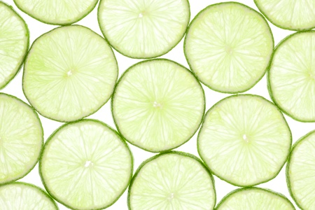 sourness: Fresh slices of lime isolated on white