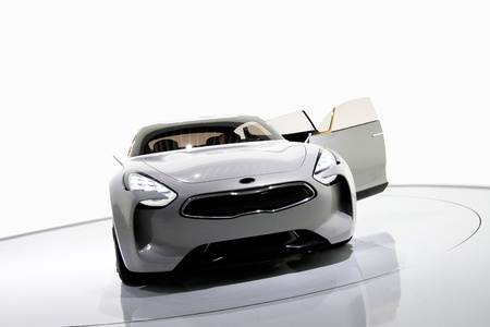 sports cars: Futuristic white sports car on a platform, isolated background