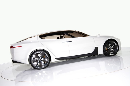 new automobiles: Futuristic white sports car on a platform, isolated background
