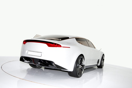 Futuristic white sports car on a platform, isolated background
