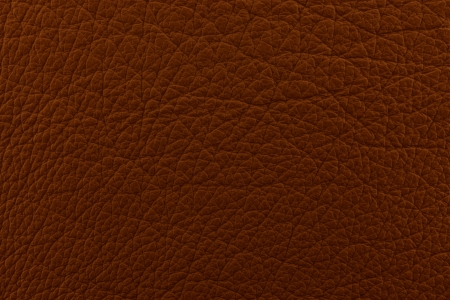 feedstock: Raw brown leather as background