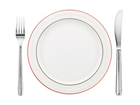 Place setting with plate, knife and fork, isolated on white