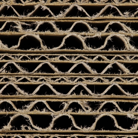 boxboard: Brown corrugated cardboard one above the other Stock Photo