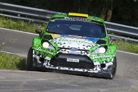Yuriy Protasov and Pavlo Cherepin compete in their Ford Fiesta RS WRC during day 2 of the ADAC rally Germany on August 23, 2014 in Trier, Germany.