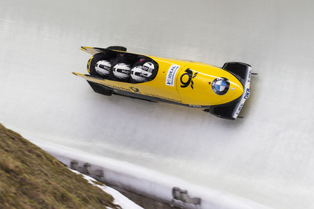 poser: Bobsleigh athlete Nico Walther of Germany competes with Marko Huebenbecker, Christian Poser and Eric Franke during the BMW IBSF World Cup Bob at Deutsche Post Eisarena on February 28, 2016 in Koenigssee, Germany. Editorial