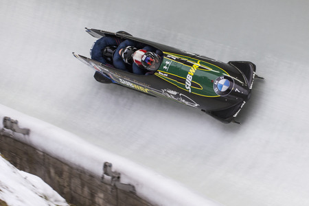 bobsleigh: Bobsleigh athlete Steven Holcomb competes with Frank Delduca, Carlo Valdes and Samuel Michener during the BMW IBSF World Cup Bob at Deutsche Post Eisarena on February 28, 2016 in Koenigssee, Germany. Editorial