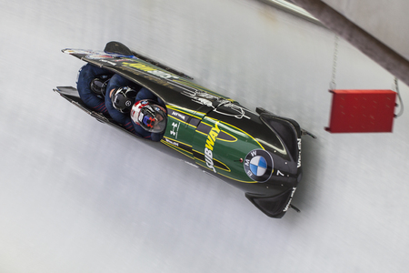 steven: Bobsleigh athlete Steven Holcomb competes with Frank Delduca, Carlo Valdes and Samuel Michener during the BMW IBSF World Cup Bob at Deutsche Post Eisarena on February 28, 2016 in Koenigssee, Germany. Editorial