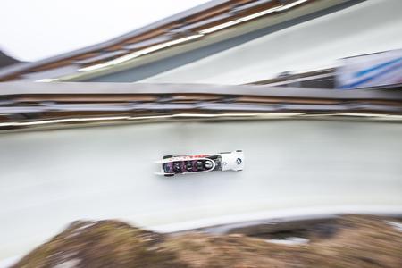 Bobsleigh Athlet Justin Kripps von Kanada konkurriert mit Alexander Kopacz, Joshua Kirkpatrick und Ben Coakwell während der BMW IBSF WM Bob bei der Deutschen Post Eisarena am 28. Februar 2016 in Königssee, Deutschland.