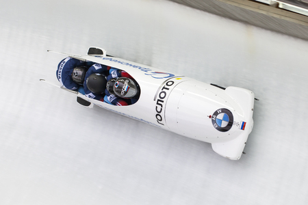 Bobsleigh athlete Alexander Kasjanov  from Russia competes with Maxim, Belugin, Maxim Mokrousov and Alexsei Pushkarev during the BMW IBSF World Cup Bob at Deutsche Post Eisarena on February 28, 2016 in Koenigssee, Germany.