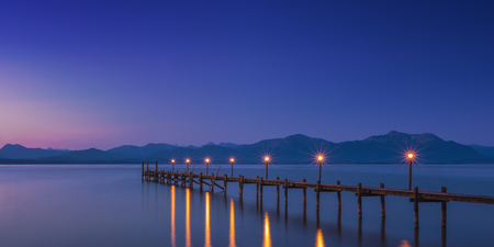 Dawn on famous lake Chiemsee, Bavaria, Germany, Panorama view 免版税图像