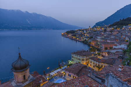 a bathing place: Popular travel destination, Limone Lake Garda at dusk, Brescia, Lombardy, Italy