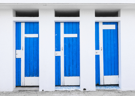 Old bathing cabin with blue wooden doors