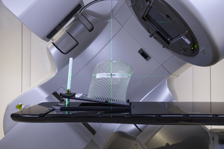 Advanced medical linear accelerator in the therapeutic oncology with a mask for fixation of a patient with brain tumor