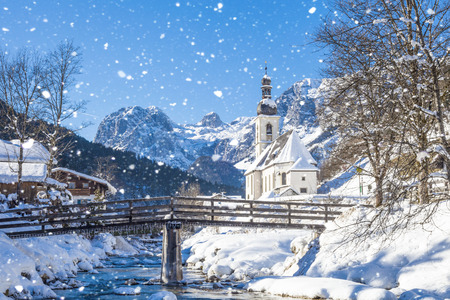 Snowfall in Ramsau, the parish church Saint Sebastian in winter, Ramsau, Berchtesgaden, Bavaria, Germany