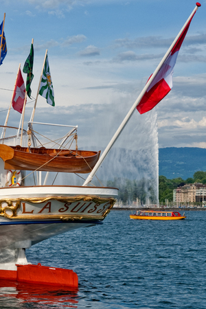 Switzerland Geneva company of traditional runs a lake navigation   Boat that crosses the lake in Geneva since 1897 The boats are painted in the colors of the city in yellow and red Editorial