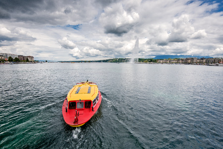 Switzerland Geneva Boat that crosses the lake in Geneva since 1897The boats are painted in the colors of the city in yellow and red Stock Photo