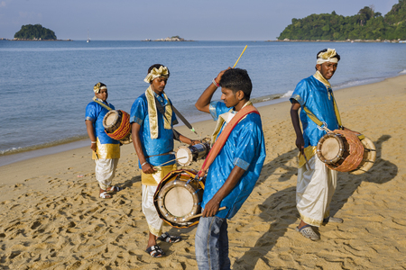 PANGKOR ISLAND, MALAYSIA - February 17, 2011 the musicians accompanies the rites of percing then the procession