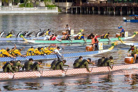 june 18, 2010 :  The finish is called by the helmsman to give more powerful or faster shots to go faster for the end of the race during the dragon boat festival on Putrajaya Lake Kuala Lumpur Malaysia Editorial