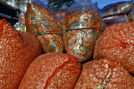 Bangkok, Thailand, Street food and market  bags of red peppers and garlic in a van before unloading at Pak Khlong Talat market in Bangkok, Thailand