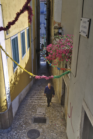 LISBON, ALFAMA, PORTUGAL - june 15, 2005 :  narrow alley of the district of Alfama