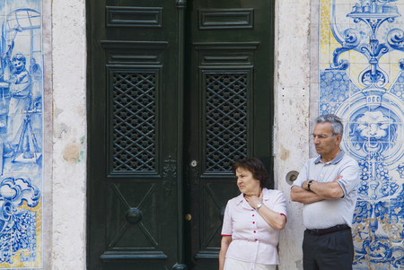 LISBON, ALFAMA, PORTUGAL - june 15, 2005 :  on the passage of the procession, a couple wait for the statue of the saint to do a prayer Editorial