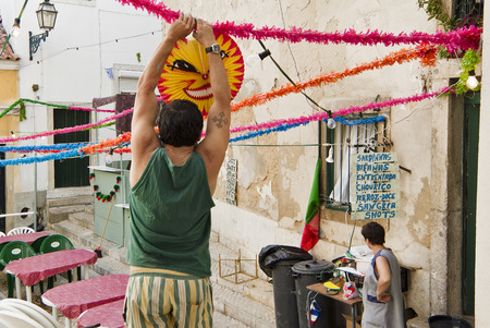 LISBON, ALFAMA, PORTUGAL - june 15, 2005 :  during the feast of St. Anthony all the streets and facades of Alfama are streaked with garlands of paper and lanterns Editorial