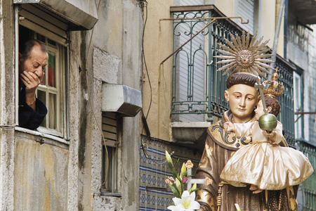 june 13, 2005 :  St. Anthonys Day, a great procession is organized. On the passage of the procession, a man  wait for the statue of the saint to do a prayer Editorial